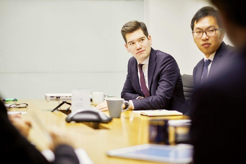 Firm partners attending a meeting