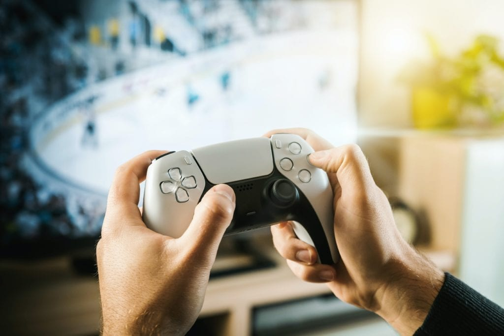 The guy is playing on the console. Modern gamepad.